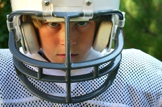 "young boy in football uniform ""Game Face"""